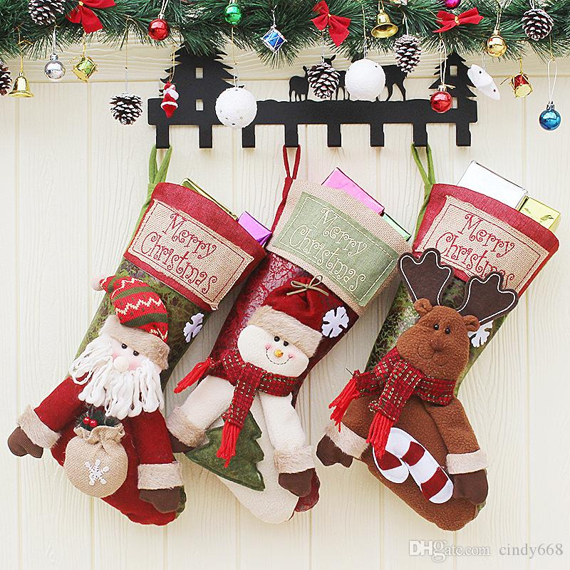 2018 christmas stocking santa claussnowmandeer sock children gift holder candy bag xmas tree ornaments party decoration unique christmas decorations