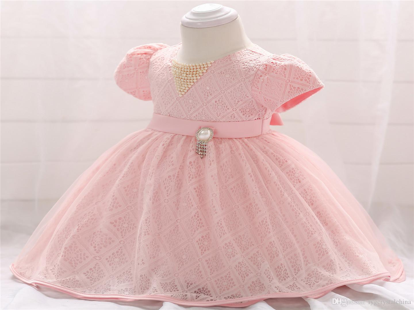 80be8466f 2018 New Collection Baby Short Sleeves Christening Gown Lace Beaded  Workmanship High Quality Princess Style Pink First Communion Dresses Online  with ...