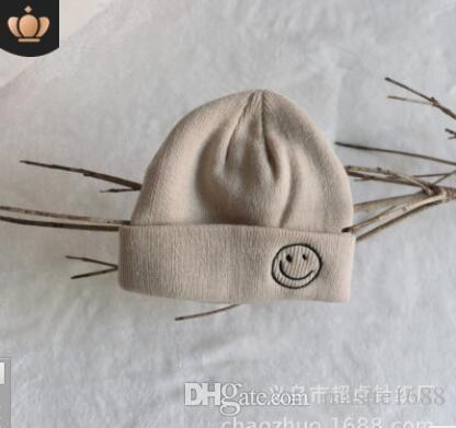 Korean Official Website With The Same Children S Smiling Face Label Woollen  Hat Children Autumn Winter New Korean Version Of The Cold Hat Knit Beanie  Cap ... d2da0a046fa
