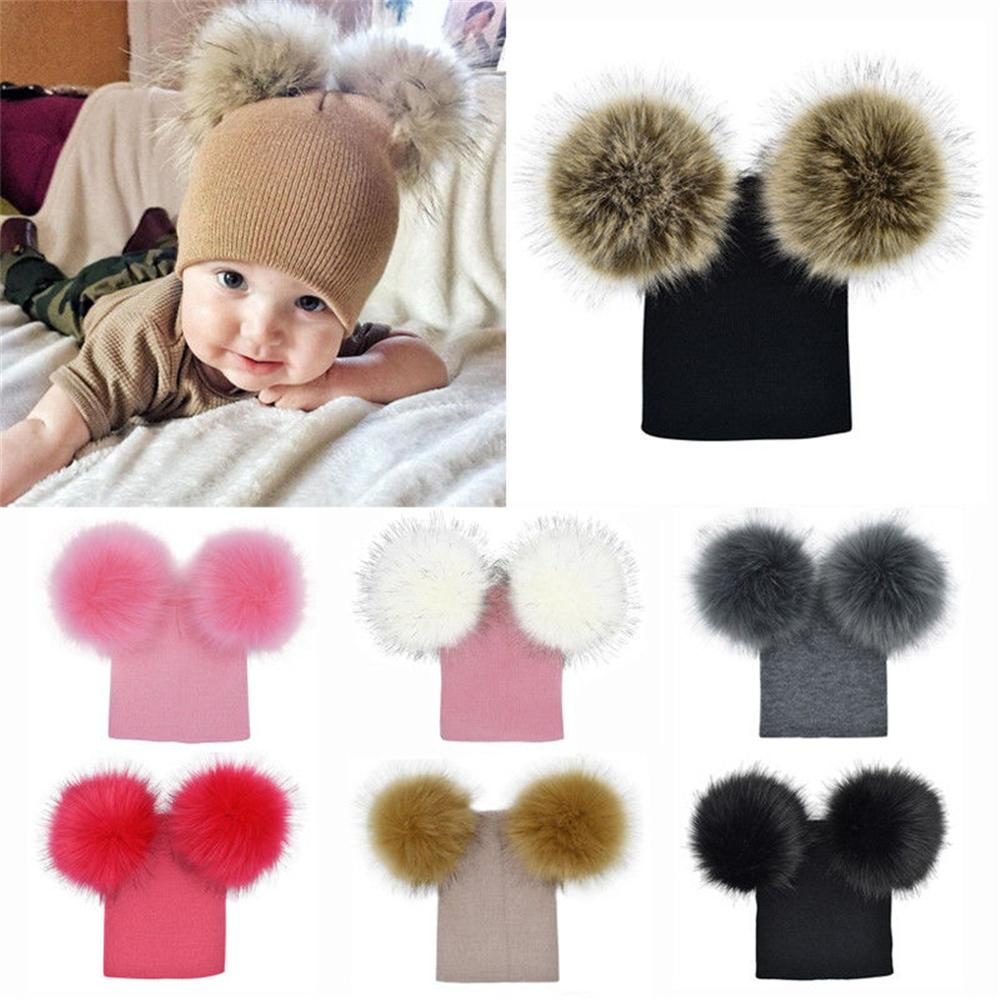 938202f6b9ae5 2019 Baby Kids Warm Autumn Winter Wool Knit Beanie Bobble Hats Caps With  Two Fur Pompom Ball Beanie Kids Hat Cotton Soft Cute Cap From Yohkoh