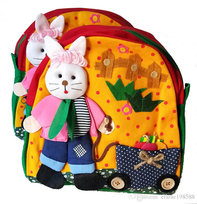 0652b0845fae Kids Baby Cartoon School Bags Lovely Rabbit Pulling A Carriage Backpack For  Kindergarten Girls Boys Handmade Cloth Bag Cotton Bags Travel Backpacks  Toddler ...