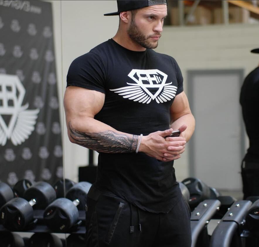 2018 year new mens fitness body engineers brand summer strong and handsome man irregular round collar t shirt with short sleeve tee shirt a day shop t