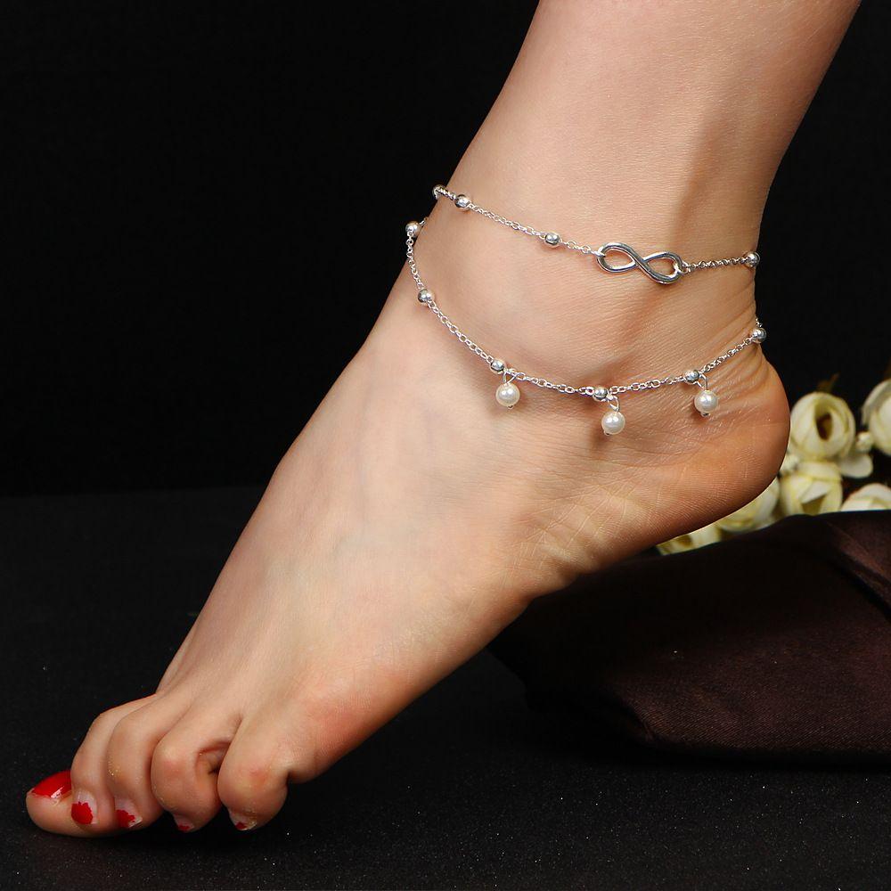 DiamondJewelryNY Double Loop Bangle Bracelet with a St Grace Charm.