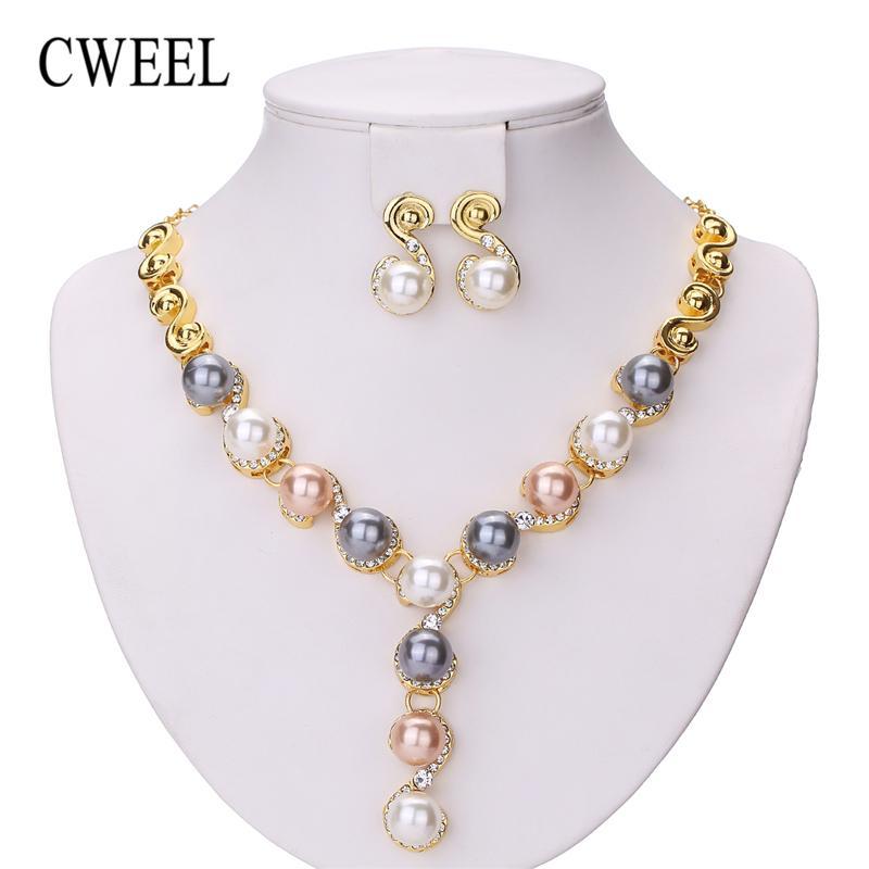 f1183adfac29 Toda la ventaCWEEL Conjuntos de joyas Boda Beads africanos Conjunto de joyas  Perlas de imitación Nupcial Dubai Indio Moda india Joyas de Navidad para ...