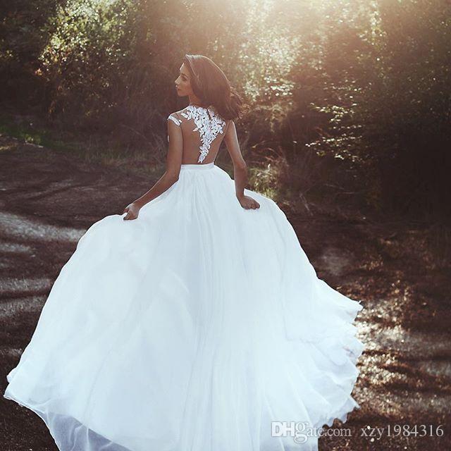 Abiti da sposa sexy senza schienale 2018 Applique di pizzo Sheer gioiello-collo senza maniche spacco laterale abito da sposa glamour Dubai abiti da sposa in chiffon