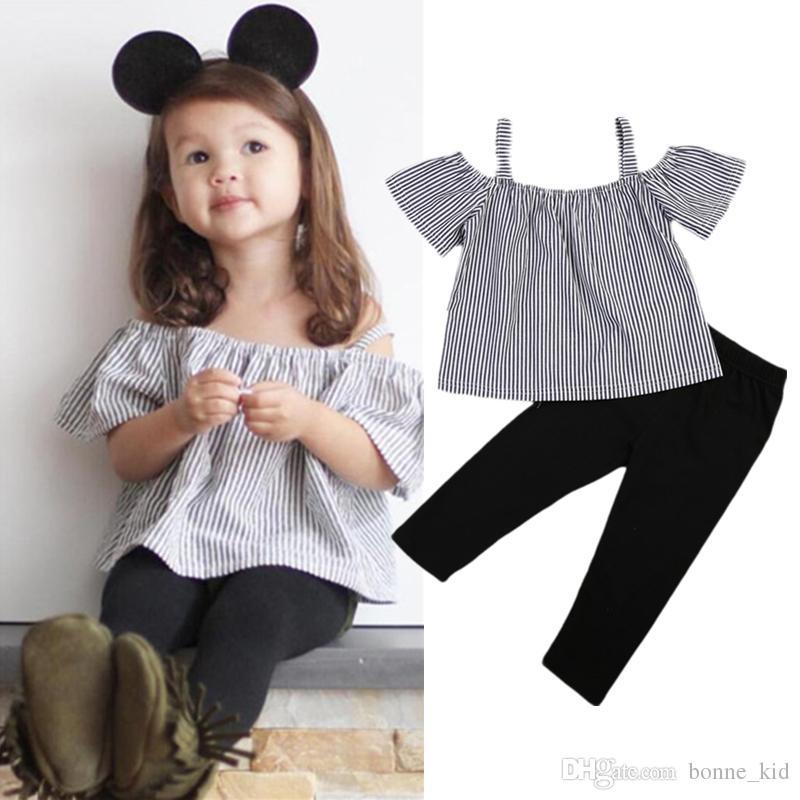 e7e5fc259d7 Compre Kid Baby Girl Off Shoulder Tops Camiseta De Rayas + Pantalones  Negros 2 Piezas Trajes Kid Ropa Casual Girls Summer Boutique Costume A   9.36 Del ...