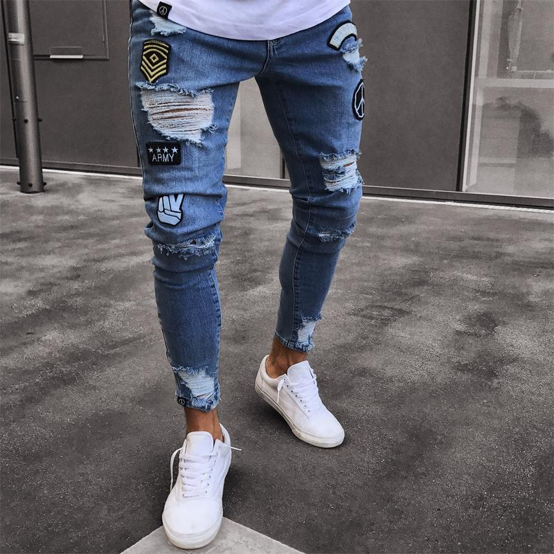 06a9b268ca6 Men's Stretchy Ripped Jeans Cartoon Patch Skinny Biker Destroyed Taped Jeans  Slim Fit Black Denim Pants 2018 New