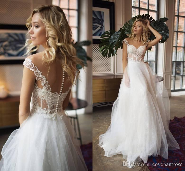 24cf13b669d6 Discount Sheer Neck Bohemian Wedding Dresses A Line Cap Sleeve Lace  Applique Beaded Beach Bridal Gowns Custom Made 2018 A Line Dresses For  Wedding Guests A ...