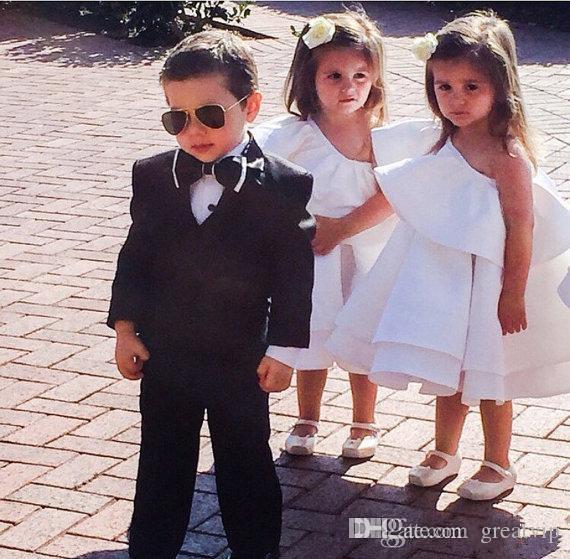 Le ragazze poco costose di fiore sveglie vestono le nozze del vestito dal vestito da spettacolo delle ragazze di lunghezza della spalla di tè una spalla gli anni dell'adolescenza