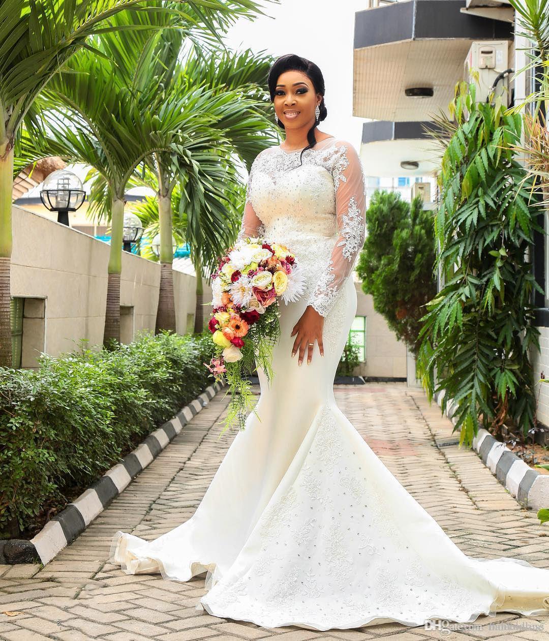Vestidos de novia de encaje vintage de sirena 2019 Sheer Manga larga Joya Apliques Con cuentas Barrido de tren Vestidos de novia africanos Talla grande personalizada