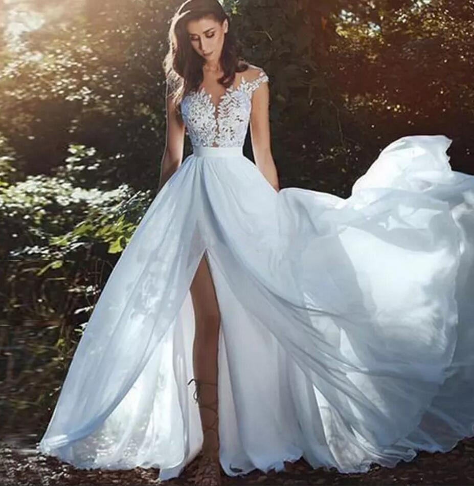 e45a3e9eae31 Discount 2019 Gorgeous Sheer Neck Beach Wedding Dresses Appliques Lace  Chiffon Side Split Bridal Dresses Illusion Back Cap Sleeves Boho Wedding  Gowns Pink ...