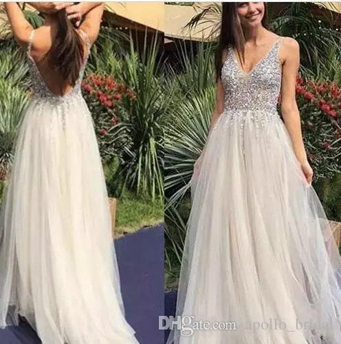 d3378b9cc3a2 2019 Sexy Prom Dresses A Line V Neck Cap Sleeve Floor Length Evening Gowns  With Crystal Beads Backless Party Gowns Halter Prom Dresses Long Lace  Dresses ...