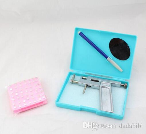 NEW ARRIVAL Professional Ear Body Nose Piercing Gun Machine Tool Kit Set + Steel Studs Piercing the Ear Guns Iron Suit