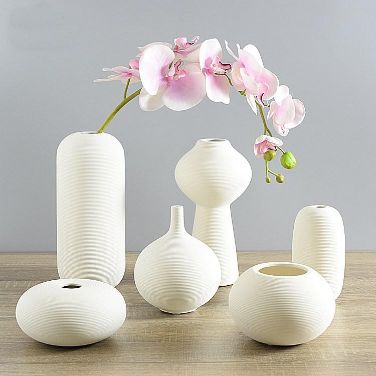 DHgate.com & small type modern creative white handmade ceramic vase flower vase / bottle furnishing ornaments for home decoration /gifts