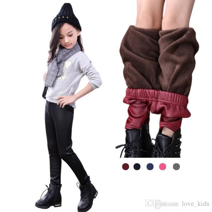 Nueva moda de invierno polainas calientes bebé niñas leggings pantalones de la PU bebé pantalones niños usan niños ropa bebé espesar pantalones de cuero