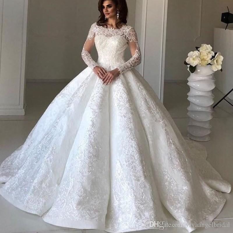 Appliques Lace Ball Gown Wedding Dresses 2019 Elegant Jewel Neck Beaded  Crystal Illusion Long Sleeves Custom Sweep Train Puffy Bridal Gowns Gown  Gowns From ... afeb178692f1