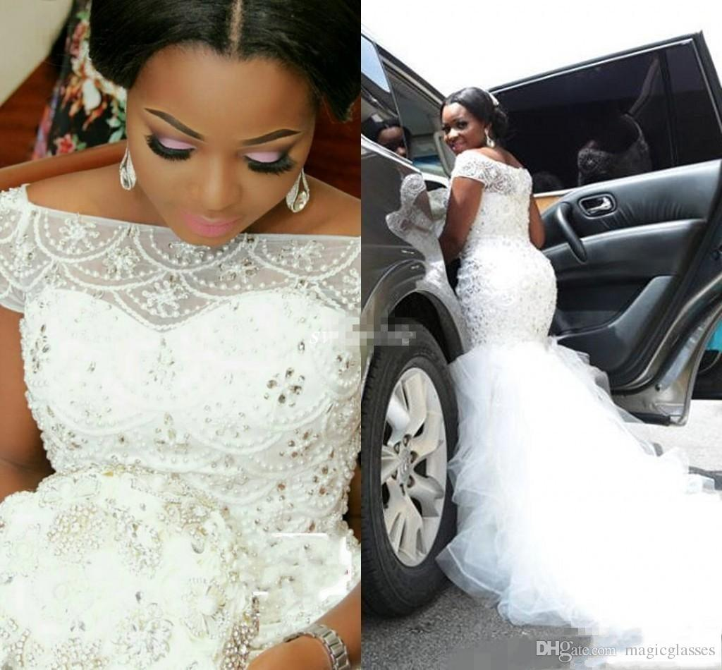 2018 Plus Size Arabic Nigerian Wedding Dresses Beading Tiered Short Sleeves Long Chapel Train Tulle Mermaid Bridal Gowns