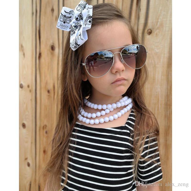 2018 طفل الفتيات مخطط خارج على الكتف اللباس الشريط bowknot lacee توتو اللباس لطيف فتاة الأزياء الحمالات التنانير الشحن المجاني