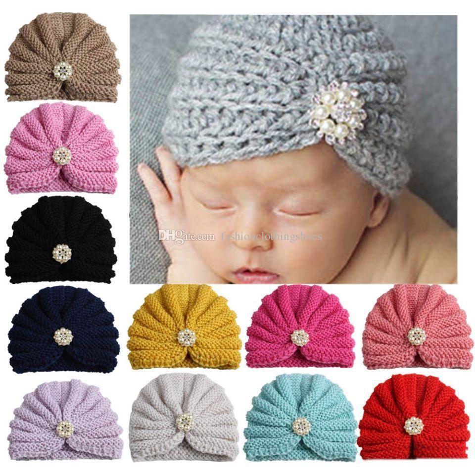 c85d1c6781ac5 Compre 2018 Moda Para Bebés Niñas De Punto Sombrero Perlas De Imitación  Perlas Niño Sombreros Niños Gorros Calientes Sombreros Turbante Niños  Sombreros es A ...