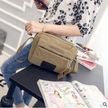 fa1656e6343 2018 Korean New Men S Shoulder Bag Trend Casual Big Men Messenger Messenger  Bag Canvas Business Retro Mini Bag 2689 Womens Handbags Body Bags From ...