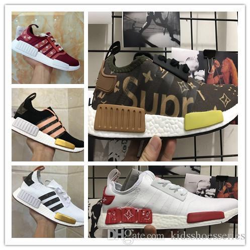 hot sale online 2d2e7 47386 Compre 2018 Nuevo NMD Runner R1 R2 Primeknit Sneakers Mejor Calidad OFF  Nuevos Hombres Y Mujeres Zapatos Corrientes Triple Blanco Negro Casual  Sport Shoes ...