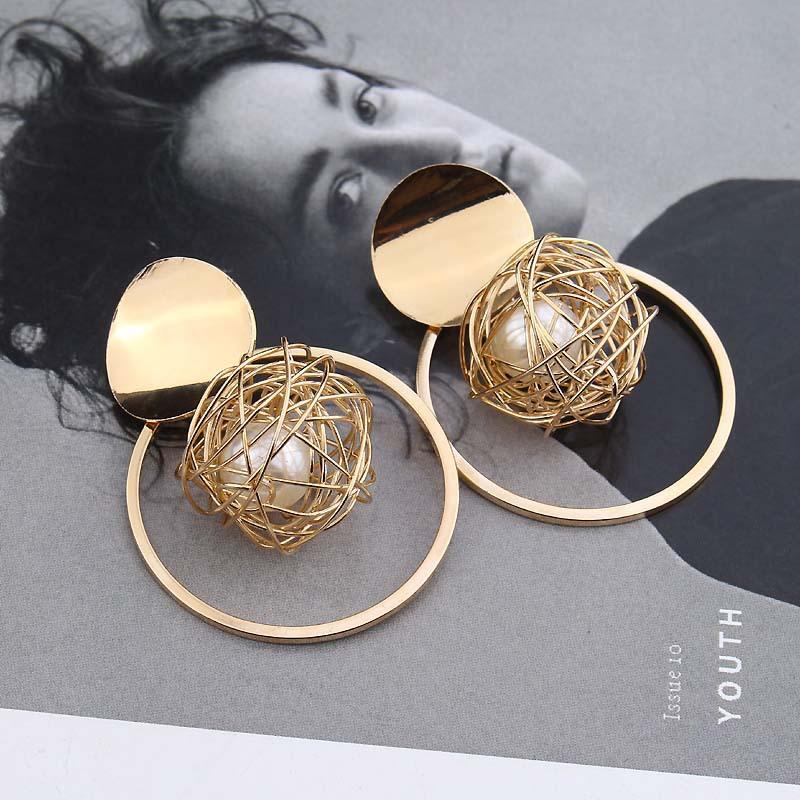 The new Europe and the United States metal rings hollow out gold ball pearl pendant earrings personality exaggerated fashion stud earrings