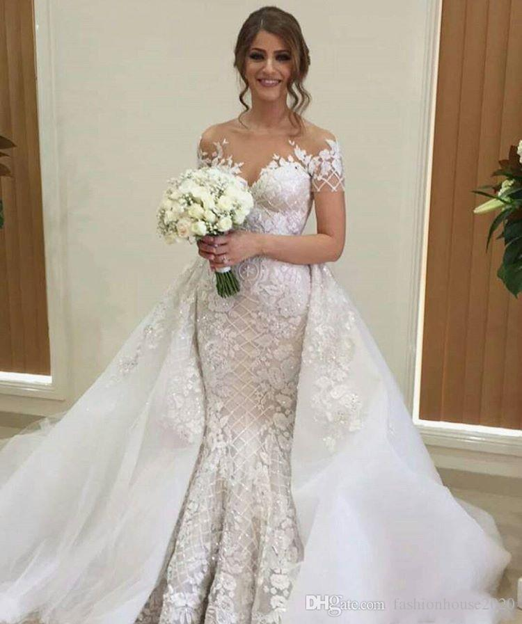 2018 Arabic Luxury Mermaid Wedding Dresses Sheer Neck 3D Floral Lace Appliques Beaded Crystal Short Sleeves Overskirts Long Bridal Gowns