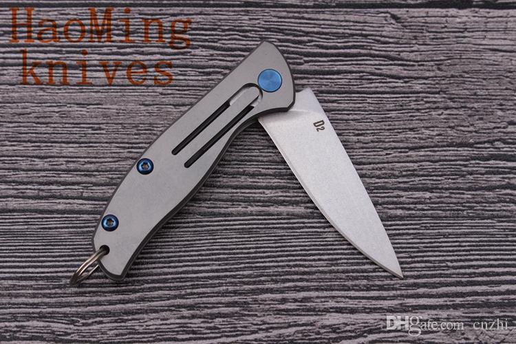 Llavero bolsillo plegable cuchillo D2 cuchilla supervivencia camping llaveros cuchillos de frutas Aleación de titanio Maneja herramientas de caza al aire libre EDC utensilios de cocina