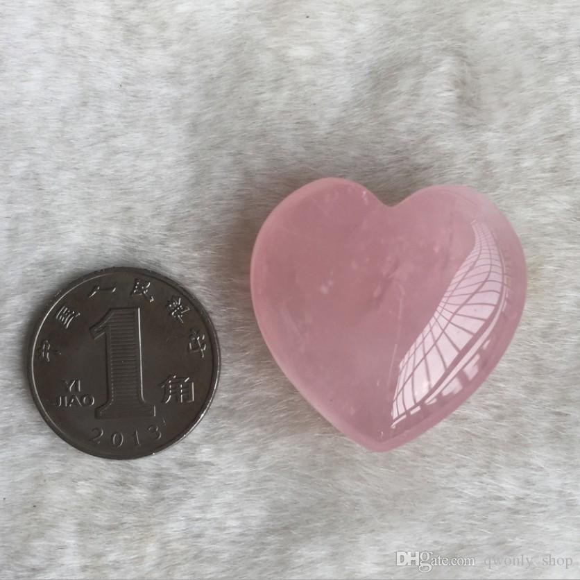 Natürliches Rosen-Quarz-Herz formte rosafarbenen Kristall geschnitzten Palme-Liebes-heilenden Edelstein-Liebhaber Gife Stein-Kristallherz-Edelsteinen