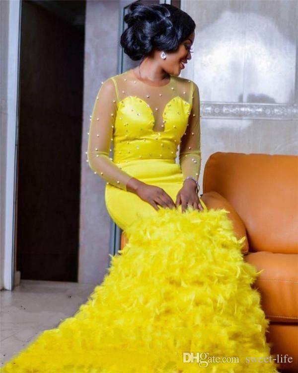 Mermaid manica lunga giallo 2019 Prom Dresses Beaded Feather Jewel Neck Illusion Lunghezza del pavimento Celebrity Red Carpet Dress Evening Wear
