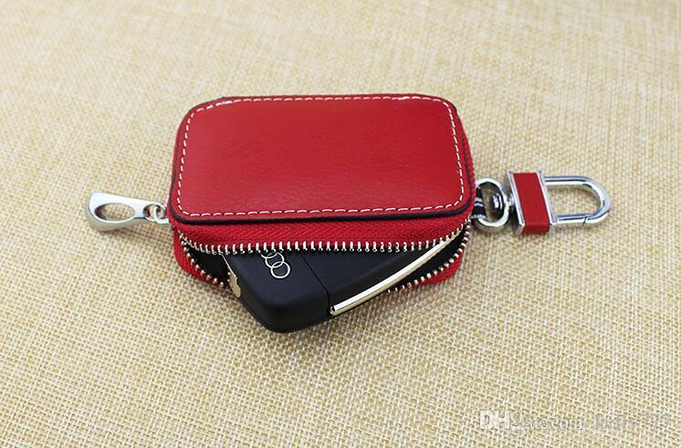 Al por mayor-hombres carteras clave de las mujeres bolso de la llave del coche de cuero genuino cráneos bolso de la moda 401
