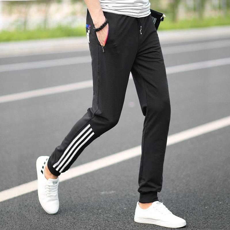 2018 Summer Men Jogger Pants Slim Fit Sweatpants Casual Joggers Skinny  Workout Trousers Striped Zipper Leisure Trousers Pants D18101305 UK 2019  From ... 76a5182623f