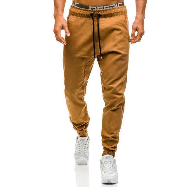 6bd53142492e4 Compre Pantalones Al Por Mayor De Los Hombres Nuevos De La Manera Del Color  Sólido Sólido De La Elasticidad De Los Hombres Pantalones Casuales Hombre  ...