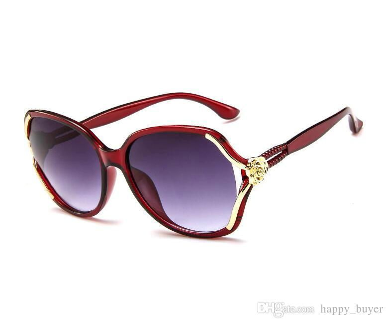 Las ventas calientes de las mujeres del diseñador gafas de sol de moda AC lente gafas de sol de viaje al aire libre de la flor en forma de marco hermoso gafas envío gratis