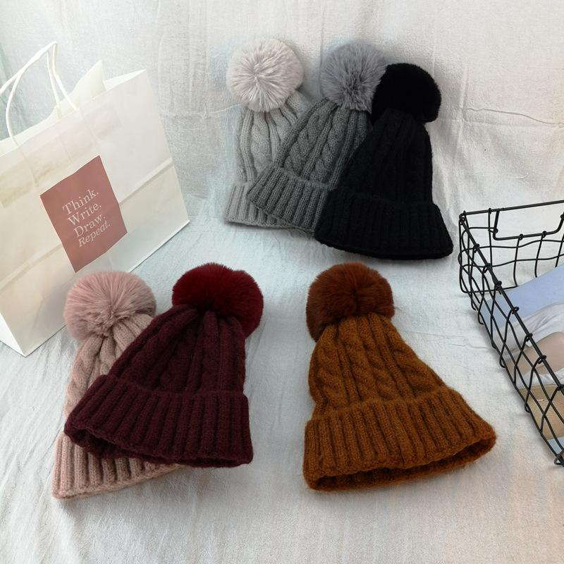 90e6b74a418 Solid Pom Poms Ball Knitted Hat Women Brand Casual Skullies Beanies ...