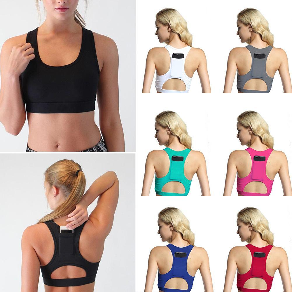 1669a82beeb 2019 Women Yoga Bra Top Back Phone Pocket Padded Hollow Out Women Sports  Bra Fitness Running Workout Running Sport Top From Bingquanwat
