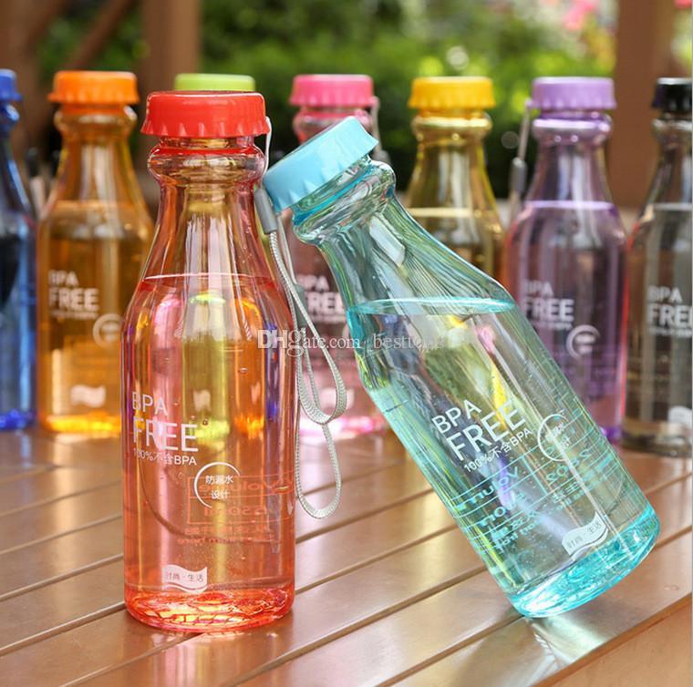 Lindo color de caramelo BPA portátil Libre de fugas Deportes a prueba de fugas Botella de agua de plástico de 550 ml inquebrantable
