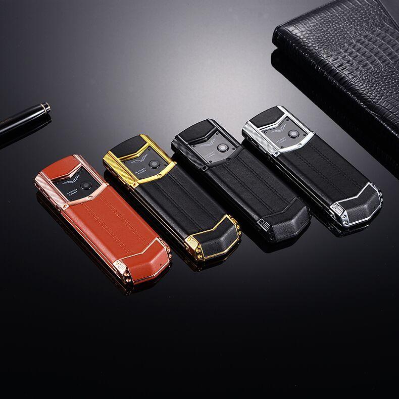 العلامة التجارية الاصلية MPARTY LT2 الفاخرة الذهب معدن الجسم جلد الإسكان الهاتف المحمول المزدوج سيم الهواتف المحمولة بلوتوث FM MP3 كاميرا الهاتف المحمول