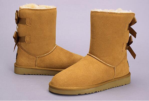 Spitzen-heißer Verkaufs-neue Art- und WeiseAustralien-niedrige Winterstiefel des echten Leders Bailey Bowknot-Frauen beugen Schneeaufladungen