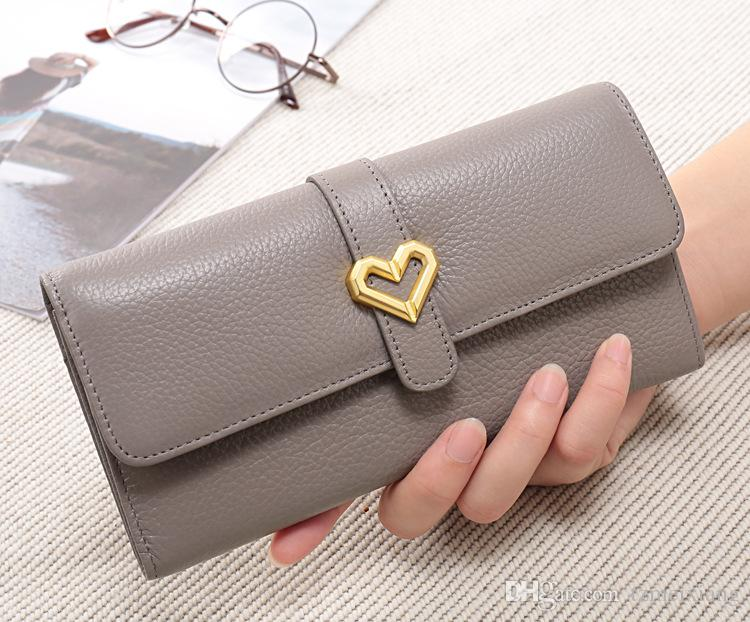 The first layer of cowhide leather ladies wallet Korean version of the solid color Litchi pattern long wallet purse short section card packa