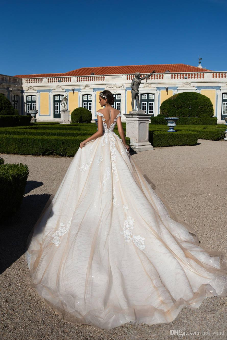 Milla Nova 2018 Champagne Elegant Cap Sleeves Wedding Dresses Sheer Neck A Line Tulle Lace Appliqued Illusion Back Bridal Gowns with Buttons