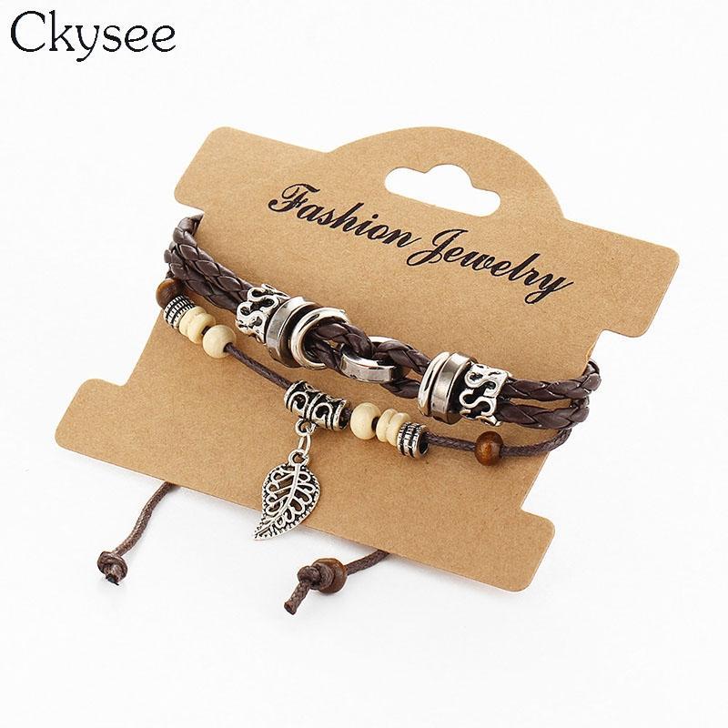 1c66e76840c0 Compre Ckysee 2 Unids   Set Pulseras De Cuero Trenzado De La Joyería Para  Los Hombres De Las Mujeres De La Hoja Del Macrame Granos De Madera Charm  Bracelet ...