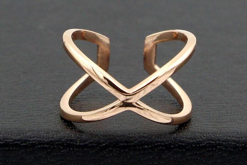 New Korean version of the hollow cross X word fashion finger ring ring Joker Titanium steel plated rose gold ring