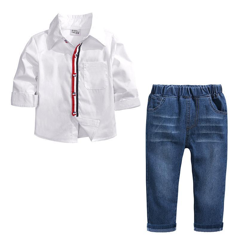 Compre 2018 Primavera Y Otoño Nuevo Patrón De Prendas De Vestir Para Niños  Niño Camisa De Solapa Blanca Jeans Trajes Twinset Ropa De Moda De Alto  Grado Para ... 039782a8a014d