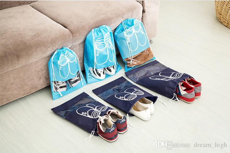 Bolsa de almacenamiento de zapatos de tela no tejida Mujeres Hombres Cubiertas a prueba de polvo Bolsos Bolsas de puerto de viaje Portas de almacenamiento Bolsa con cordón