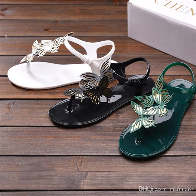 Las mujeres al por mayor de plástico Zoris playa jalea sandalias de la correa de color caramelo flip-flops Summer Flat Bottomed Out Wading zapatos tobillo-Wrap mariposa