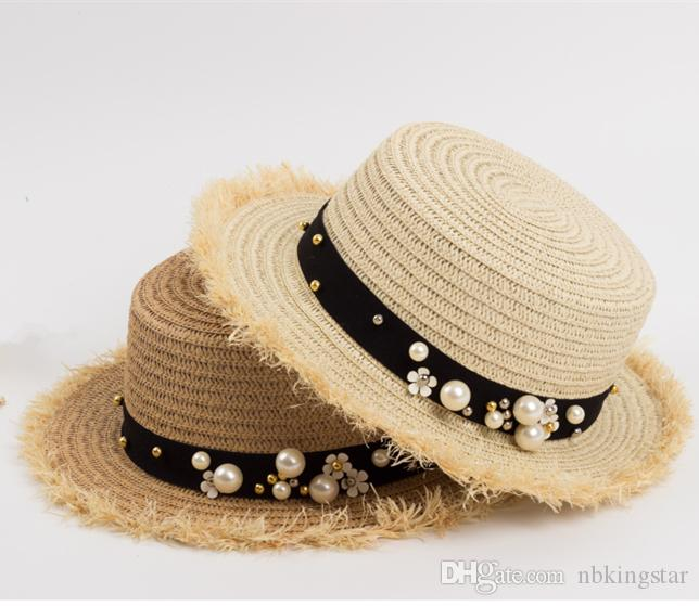 887c3ec9228 2018 Summer Women Flat Top Straw Hat With Pearl Flloral Ady Beach Wide Brim  Sun Hat Fur Hats Men Hats From Nbkingstar