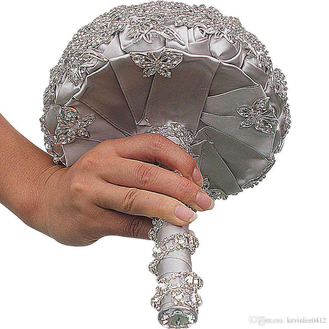 https://www.dhresource.com/0x0s/f2-albu-g7-M00-A0-98-rBVaSlta3HWAbk3kAAh5Ok81gYI888.jpg/luxury-crystal-pearls-bridal-wedding-silver-flower-bouquet-brooch-bride-hand-flowers-wedding-favors-hand-holding-decoration-handmade.jpg
