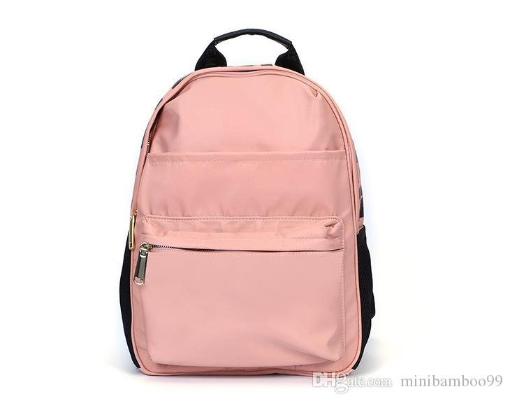 55c2cf21e9 2018 New Women Backpacks Pink Nylon Backpack Casual Pure Color Fashion School  Bags Durable And Lightness Pink Color Waterproof High Quality Best  Messenger ...
