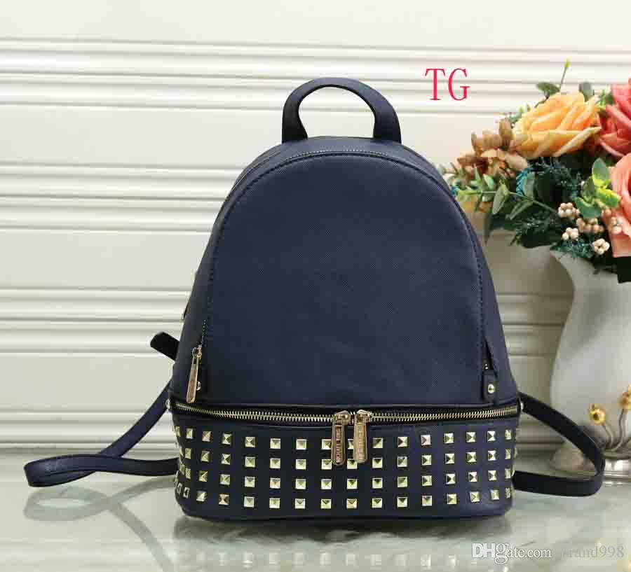 Luxury Brand New Arrival Fashion Women Travel Bag Punk Rivet Backpack  School Bag Unisex Backpack Student Bag Men Travel Brand Bags Brand Backpack  Style ... 7df13be7b8087